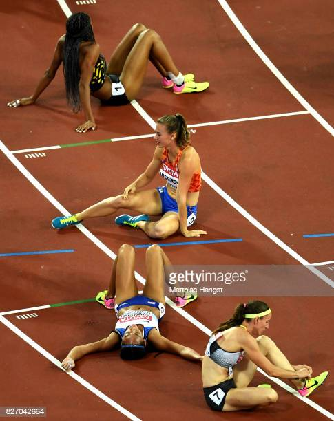 Nadine Visser of the Netherlands Katarina JohnsonThompson of Great Britain and others react after the Women's Heptathlon 800 metres during day three...