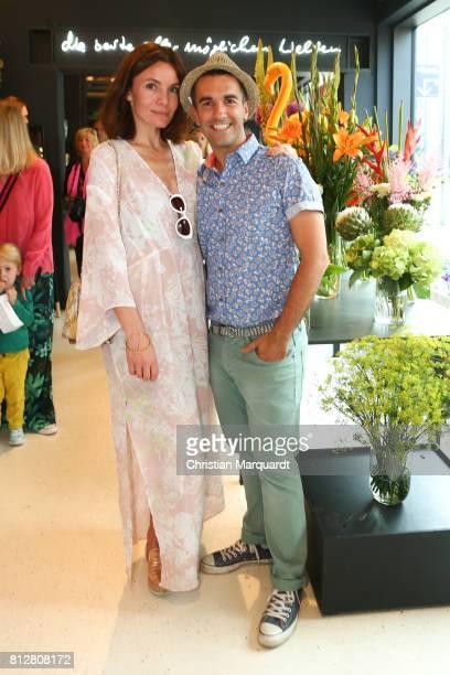 Nadine Warmuth and Kian ShamsDolatabadi attend the 'Kians Garden Flower Shop' Opening Event at Kantstrasse on July 11 2017 in Berlin Germany