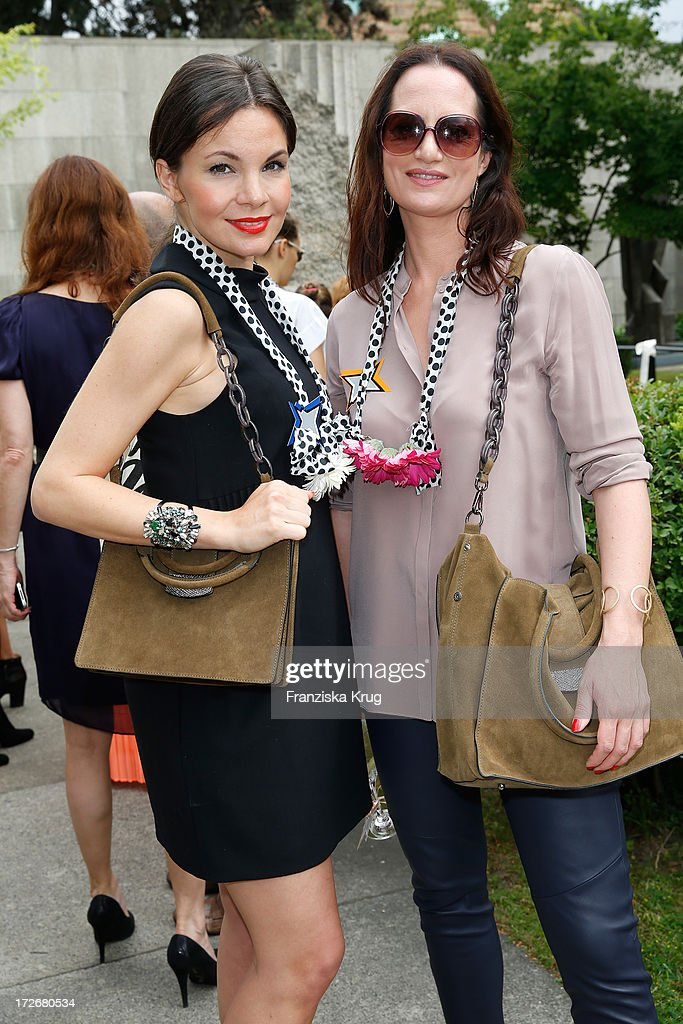 Nadine Warmuth and Natalia Woerner at the Schumacher After Show Party at Brandenburg Gate on July 4, 2013 in Berlin, Germany.
