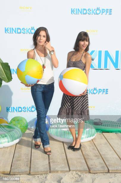 Nadine Warmuth and Susan Hoecke attend the Beach BBQ for the German Premiere of 'Kindskoepfe' at O2 World on July 30, 2010 in Berlin, Germany.