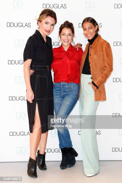 Nadine Warmuth, Anna Julia Kapfelsperger and Rabea Schif attend the re-opening of the Douglas flagship store on October 9, 2018 in Frankfurt am Main,...