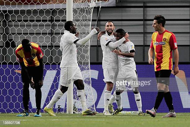 Nadir Belhadj of Al Sadd Club congratulates goal scorer Khalfan Al Khalfan during the FIFA Club World Cup Quarter Final match between Esperance...