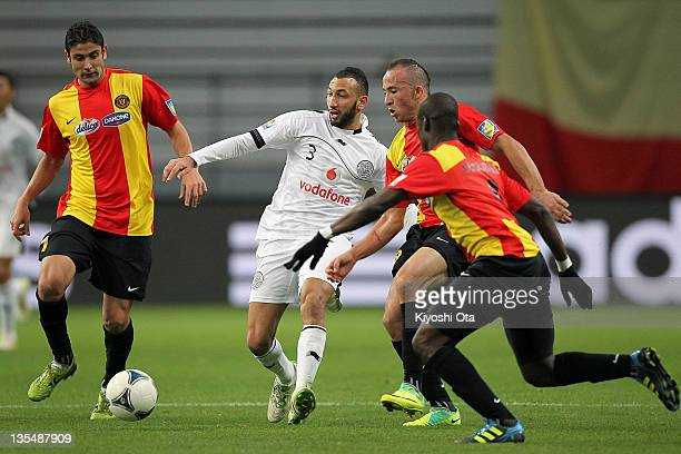 Nadir Belhadj of AlSadd controls the ball amongst the Esperance Sportive de Tunis players during the FIFA Club World Cup Quarter Final match between...