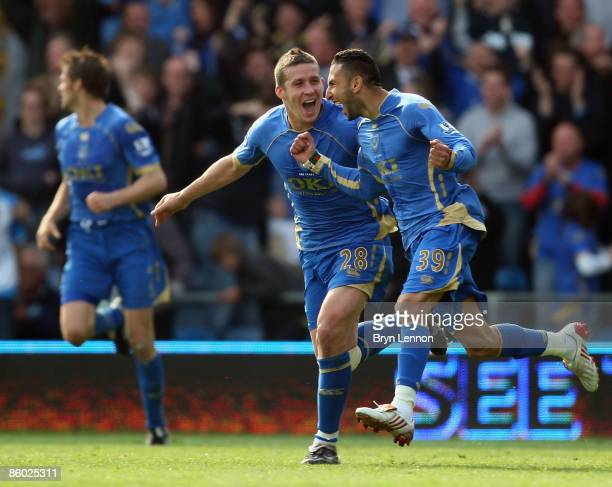 Nadir Belhadj of Portmouth celebrates with team mates after scoring during the Barclays Premier League match between Portsmouth and Bolton Wanderers...
