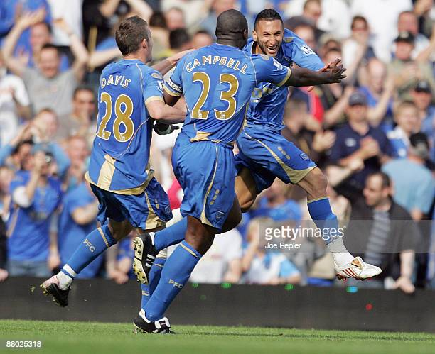 Nadir Belhadj of Portsmouth celebrates scoringthe opening goal during the Barclays Premier League match between Portsmouth and Bolton Wanderers at...