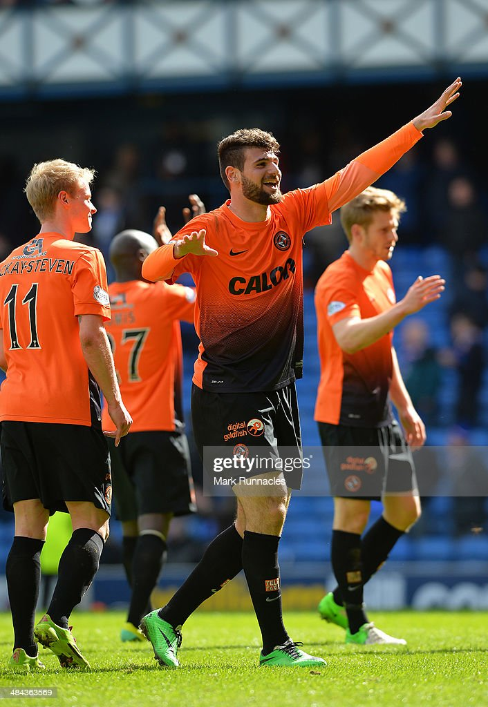 Nadir Ciftci celebrates Dundee United winning the the William Hill Scottish Cup Semi Final between Rangers and Dundee United at Ibrox Stadium on April 12, 2014 in Glasgow, Scotland.