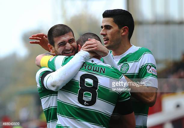 Nadir Ciftci of Celtic celebrates scoring with Scott Brown of Celtic during the Ladbrokes Scottish Premiership match between Motherwell and Celtic at...