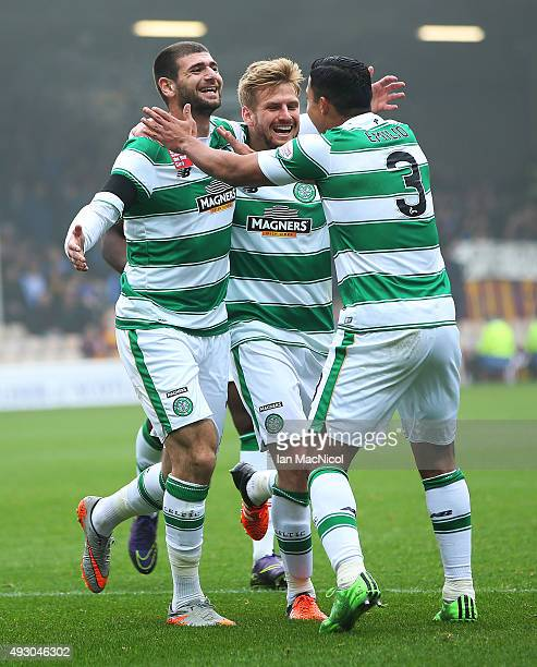 Nadir Ciftci of Celtic celebrates scoring with Stuart Armstrong and Emilio Izaguirre during the Ladbrokes Scottish Premiership match between...