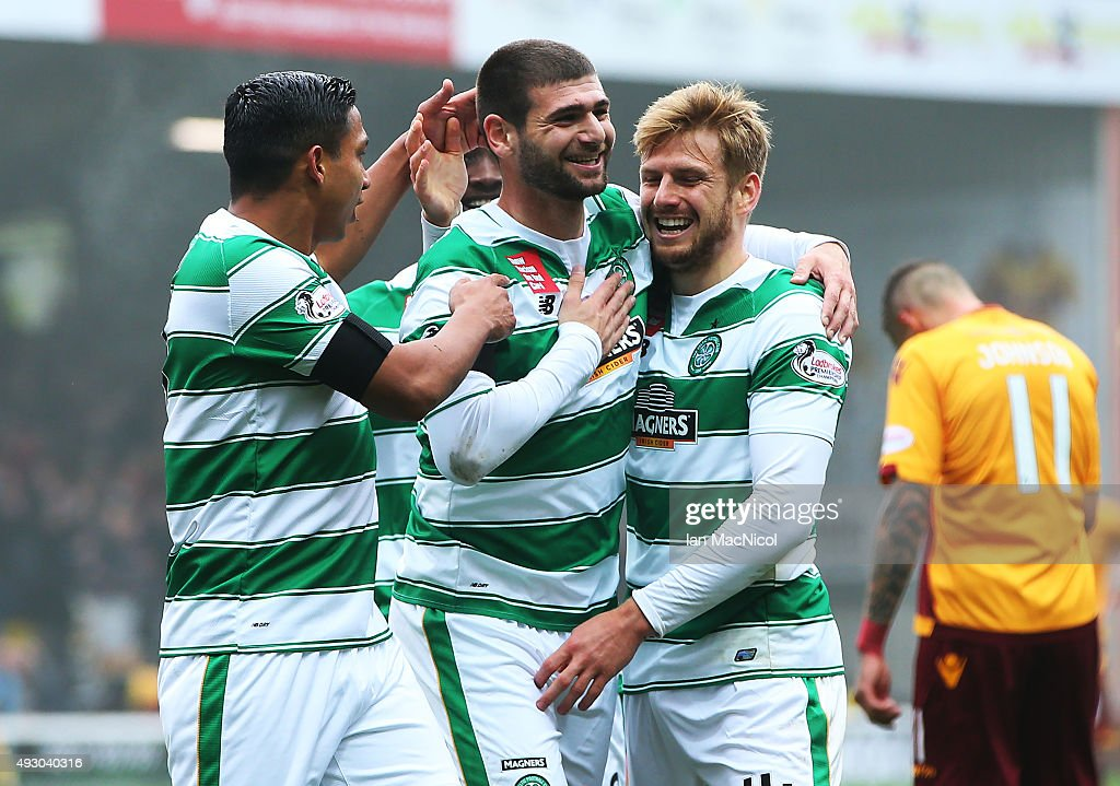 Nadir Ciftci of Celtic celebrates scoring with Stuart Armstrong of Celtic during the Ladbrokes Scottish Premiership match between Motherwell and Celtic at Fir Park on October 17, 2015 in Motherwell, Scotland.