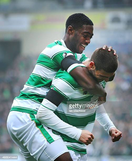 Nadir Ciftci of Celtic celebrates scoring with Tyler Blackett of Celtic during the Ladbrokes Scottish Premiership match between Motherwell and Celtic...