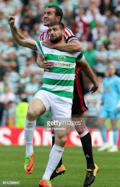 Nadir Ciftci of Celtic tangles with John O'Shea of Sunderland during a preseason friendly match between Sunderland AFC and Celtic at the Stadium of...