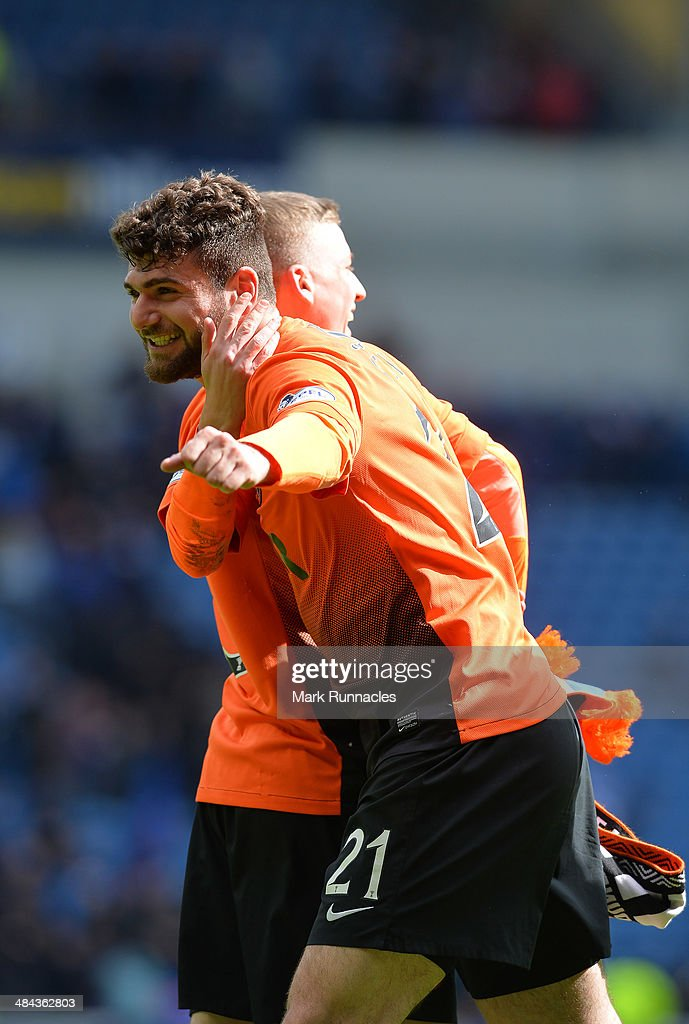 Nadir Ciftci of Dundee celebrates their victory during the William Hill Scottish Cup Semi Final between Rangers and Dundee United at Ibrox Stadium on April 12, 2014 in Glasgow, Scotland.