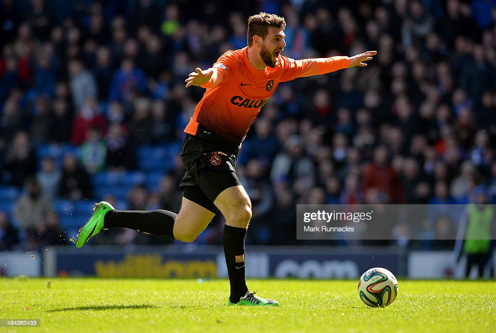 Nadir Ciftci of Dundee United celebrates scoring during the William Hill Scottish Cup Semi Final between Rangers and Dundee United at Ibrox Stadium on April 12, 2014 in Glasgow, Scotland.