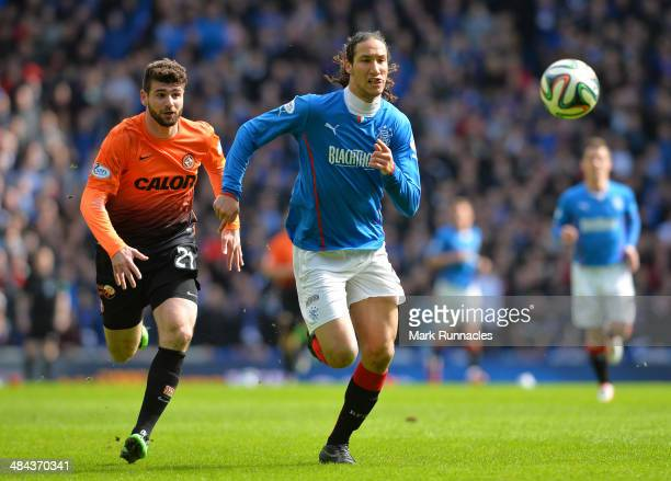 Nadir Ciftci of Dundee United chases Bilel Mohsni of Rangers during the William Hill Scottish Cup Semi Final between Rangers and Dundee United at...