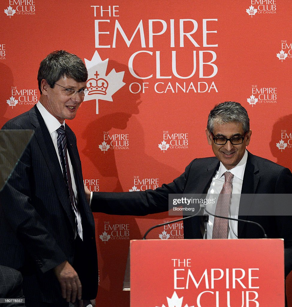 "Nadir Mohamed, president and chief executive officer of Rogers Communications Inc., right, introduces Thorsten Heins, chief executive officer of BlackBerry, during an event at the Empire Club of Canada in Toronto, Ontario, Canada, on Tuesday, Feb. 5, 2013. Heins said early sales of the Z10 smartphone are ""encouraging"" and that users are switching from other platforms. Photographer: Aaron Harris/Bloomberg via Getty Images"