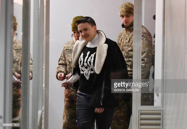 TOPSHOT Nadiya Savchenko enters to dock's cabine during a hearing in Kiev's district court on March 23 2018 Ukrainian MP Nadiya Savchenko once hailed...