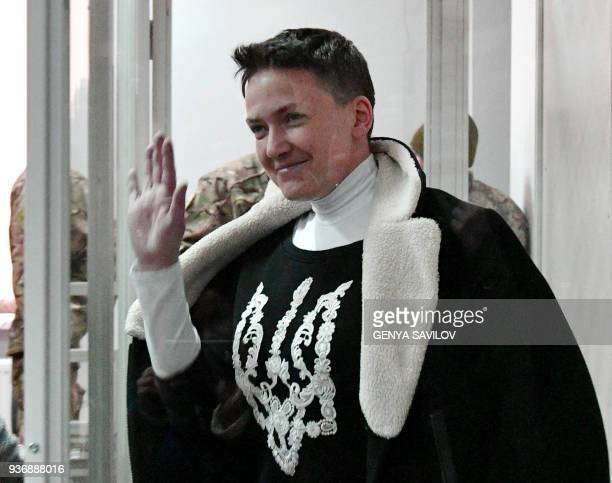Nadiya Savchenko enters to dock's cabine during a hearing in Kiev's district court on March 23 2018 Ukrainian MP Nadiya Savchenko once hailed as a...