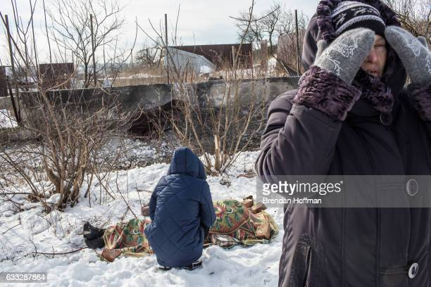Nadiya Volkova grieves over the body of her mother Katya Volkova who was killed by shelling at around 730am as she walked to the store as Nadiya's...