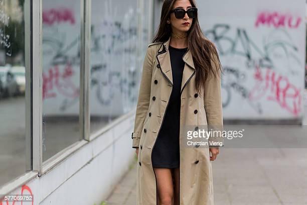 Nadja Ali wearing a beige Burberry trench coat, a black Zara dress on July 18, 2016 in Berlin, Germany.