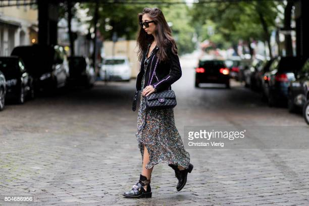 Nadja Ali wearing a black leather jacket Be Edgy a maxi dress with floral all over print Lala Berlin a black Chanel bag Balenciaga boots Celine...