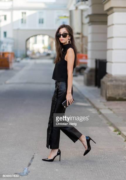 Nadja Ali wearing a black sleeveless shirt Topshop black Lala Berlin pants black Saint Laurent heels Celine sunglasses during the MercedesBenz...