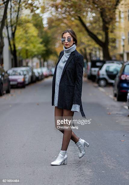 Nadja Ali wearing a black white stripped blazer from Edited a grey turtleneck sweater with long sleeves from Edited Falke tights silver Asos ankle...