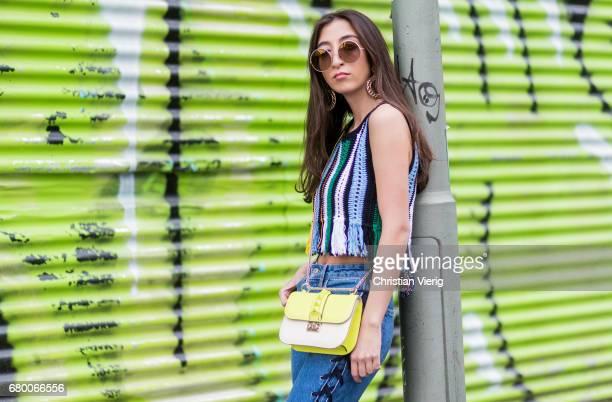 Nadja Ali wearing a Lala Berlin Top blue HM denim Jeans black Balenciaga Boots a neon yellow green Valentino Bag Marc Jacobs sunglasses vintage...