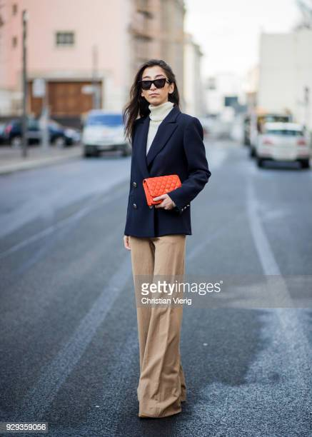 Nadja Ali wearing a Tara Jarmon blazer beige wide leg Mango pants white turtleneck Uniqlo pointed shoes Ayede Celine sunglasses orange Chanel bag is...