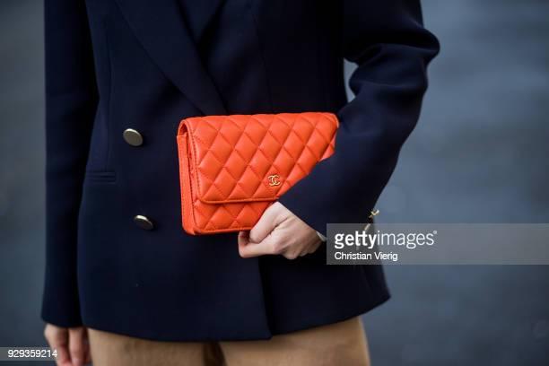 Nadja Ali wearing a Tara Jarmon blazer beige wide leg Mango pants white turtleneck Uniqlo pointed shoes Ayede Celine sunglasses orange Chanel bag is...