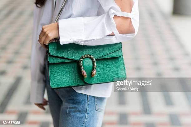 Nadja Ali wearing a white blouse with slit Lala Berlin ripped denim jeans Levis green Gucci bag green Adiletten bathing shoes Adidas Celine...