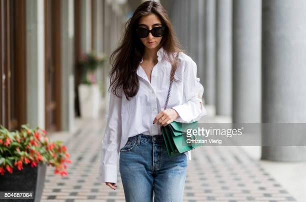 Nadja Ali wearing a white blouse with slit Lala Berlin ripped denim jeans Levis green Gucci bag green 'Adiletten' bathing shoes Adidas Celine...