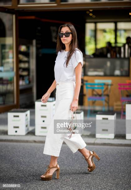 Nadja Ali wearing a white tshirt from Local Authority white flared cropped jeans HM Jimmy Choo shoes Jimmy Choo bag Celine sunglasses is seen on May...