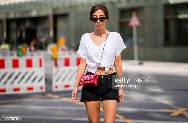 Nadja Ali wearing black Levis shors YSL sneakers white Zara tshirt HM sunglasses Jimmy Choo bag on August 2 2018 in Berlin Germany