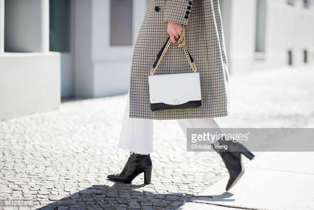 Nadja Ali wearing grey checked coat HM trend shirt Lala Berlin mih white denim jeans Zara ankle boots Aigner bag Vogue Eyewear sunglasses is seen on...