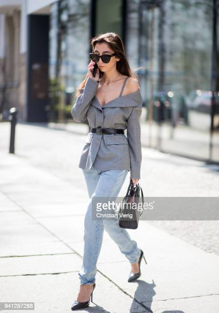 Nadja Ali wearing grey Prada blazer Levis denim jeans Saint Laurent heels Saint Laurent bag Le Specs sunglasses is seen on March 30 2018 in Berlin...