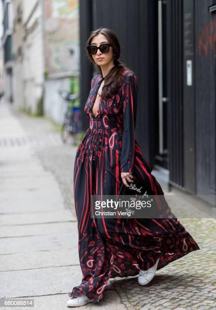 Nadja Ali wearing Lala Berlin dress black Celine sunglasses Adidas sneaker black Gucci clutch with the print blind for love on May 7 2017 in Berlin...