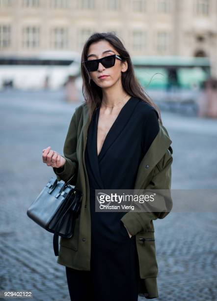 Nadja Ali wearing Lala Berlin parka Kiomi overall Vans Celine sungalsses Saint Laurent bag is seen on March 8 2018 in Berlin Germany