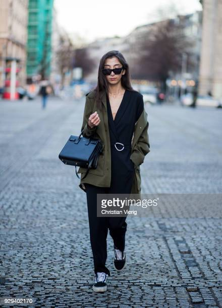 Nadja Ali wearing Lala Berlin parka Kiomi overall Vans Celine sungalsses Saint Laurent bag is seen on March 8 2018 in Berlin Germany
