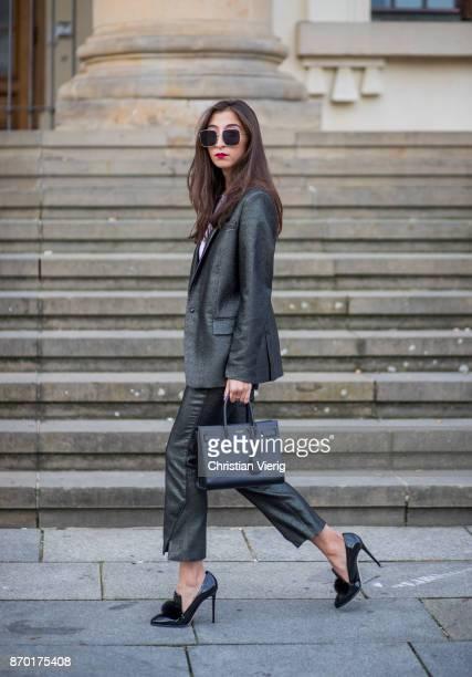 Nadja Ali wearing Lala Berlin suit Jimmy Choo bag Saint Laurent bag Dior sunglasses Chanel necklace on November 4 2017 in Berlin Germany