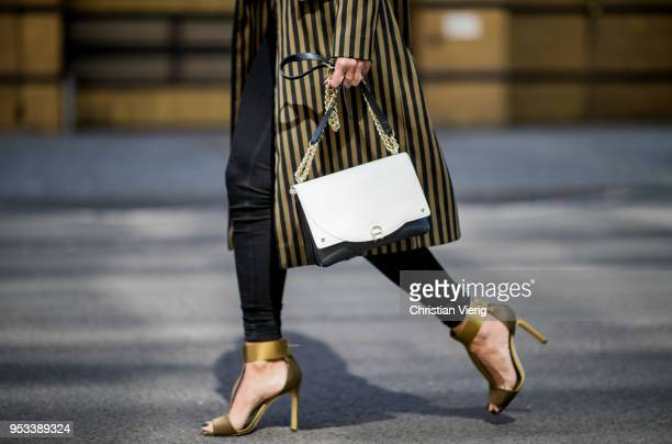 Nadja Ali wearing Mango shirt black Rag Bone pants Jimmy Choo heeled sandals golden black striped Lala Berlin coat Aigner bag Celine sunglasses is...