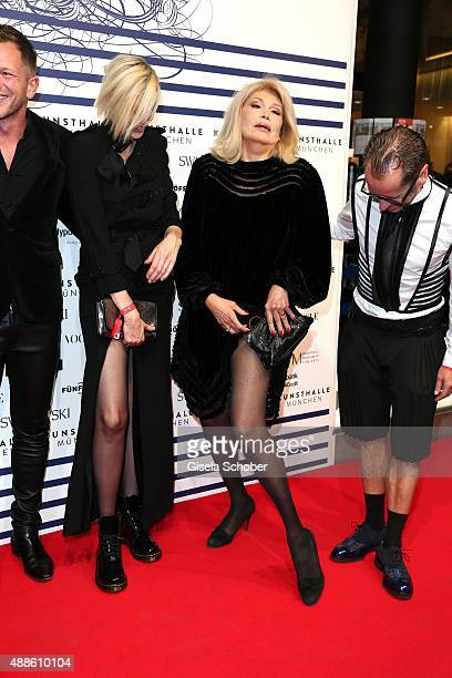 Nadja Auermann and Amanda Lear shows her leg Dr Roger Diederen Director Kunsthalle Muenchen during the opening of the exhibition Jean Paul Gaultier...