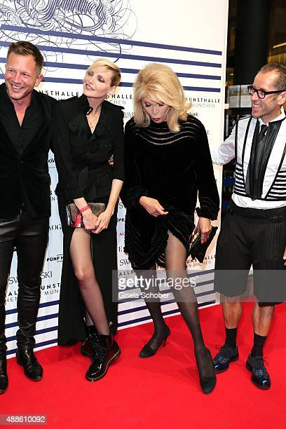Nadja Auermann and Amanda Lear shows her leg during the opening of the exhibition Jean Paul Gaultier 'From The Sidewalk To The Catwalk' at Kunsthalle...
