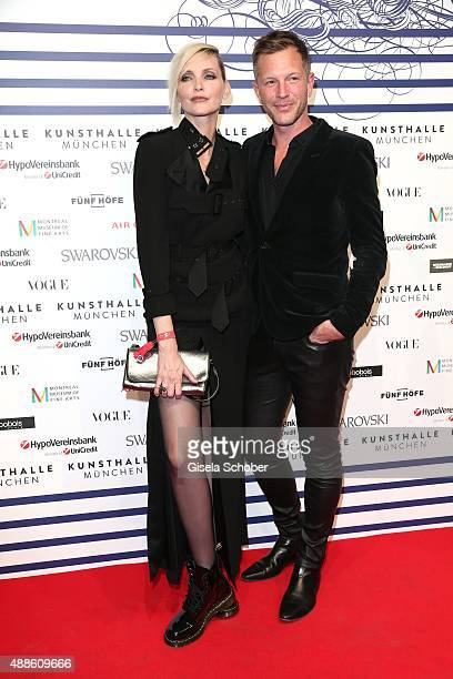 Nadja Auermann and Curator ThierryMaxime Loriot during the opening of the exhibition Jean Paul Gaultier 'From The Sidewalk To The Catwalk' at...
