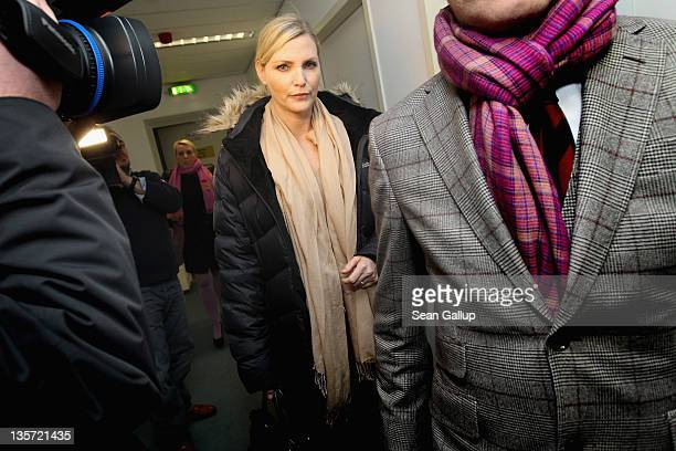 Nadja Auermann arrives with her lawyer for what was scheduled to be a verdict in charges of tax evasion against her at the Amtsgericht Tiergarten...