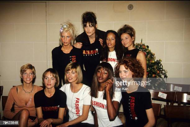 Nadja Auermann Carla Bruni Amber Valletta Linda Evangelista Naomi Campbell Shalom Harlow and Top Models wearing Fashion Aid Clothing Tee Shirts Pose...