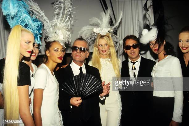 Nadja Auermann, Carla Bruni, Brandi Quinones, Karl Lagerfeld, Claudia Schiffer, Gilles Dufour, Christy Turlington and Karen Mulder attend a Chanel...