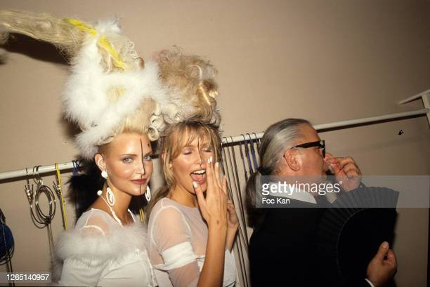 Nadja Auermann, Claudia Schiffer and Karl Lagerfeld attend a Chanel Show during A Paris Fashion Weeks in the 1990s in Paris, France.