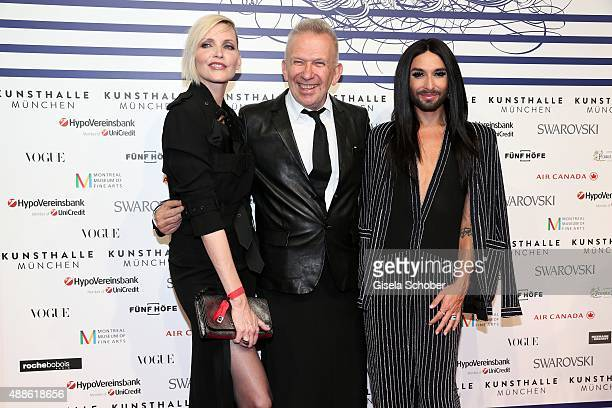 Nadja Auermann Designer Jean Paul Gaultier and Singer Conchita Wurst during the opening of the exhibition Jean Paul Gaultier 'From The Sidewalk To...