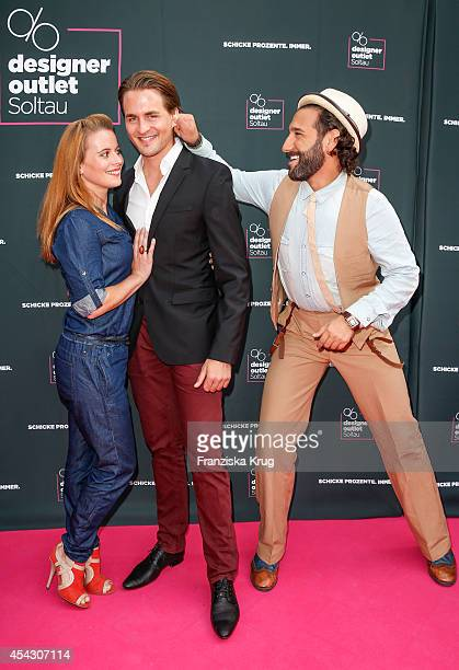 Nadja Scheiwiller Alexander Klaws and Massimo Sinato attend the Late Night Shopping Designer Outlet Soltau on August 28 2014 in Soltau Germany