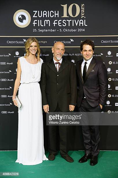 Nadja Schildknecht John Malkovich and Karl Spoerri attend the Award Night Green Carpet Arrivals during Day 10 of Zurich Film Festival 2014 on October...